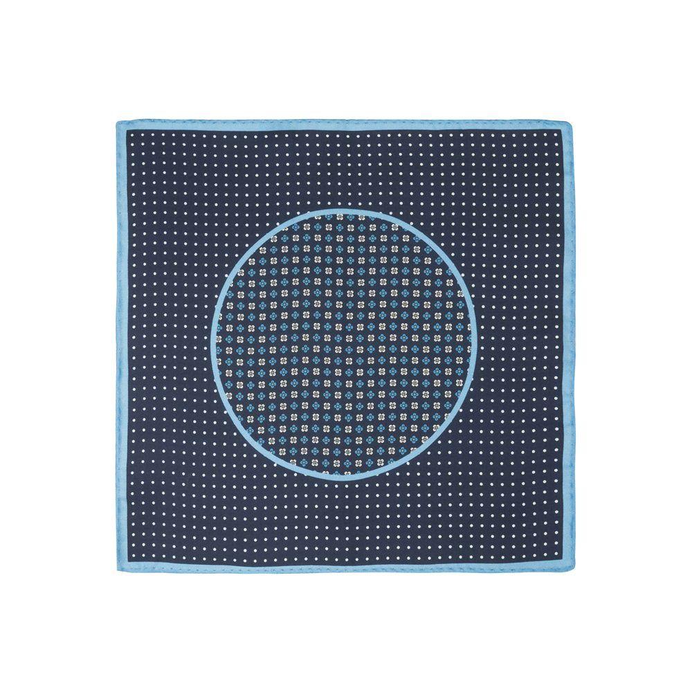 Pañuelo azul oscuro con estampado de puntos blancos, flores en la parte central y marco azul claro en seda de origen Español.