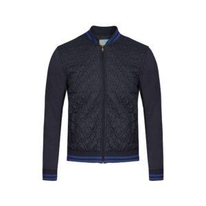 Chaqueta azul oscura acolchada tipo bomber con combinaciones en textiles, contrastes en cuello y puño, silueta regular de origen Español.